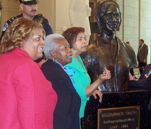My friend Kim Trent (far left), activist Annette Rainwater and National Congress of Black Women President E. Faye Williams stand with a bust of freedom fighter Sojourner Truth, the first black woman to be acknowledged with a statue in the US Capitol's statutory collection
