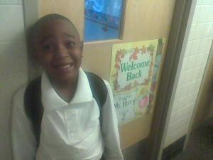 Joshua outside of 2nd grade classroom